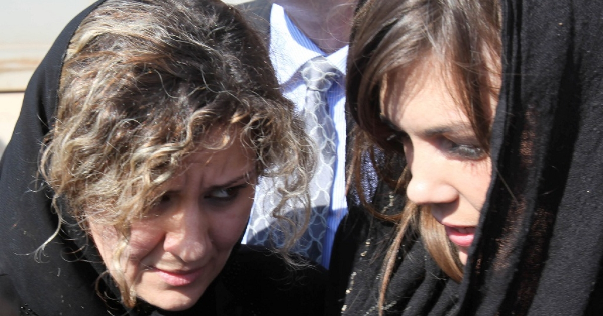 Australian lawyer Melinda Taylor (R) and her interpreter from Lebanon, Helene Assaf (L) are seen following their release from detention in Zintan, Libya, on July 2, 2012.</p>