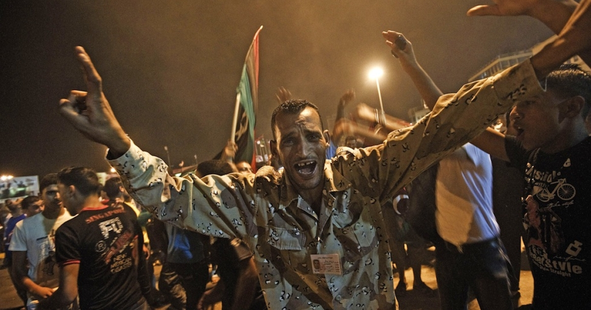 Tens of thousands of Libyans celebrate the arrest of Muammar Gaddafi's son Saif al-islam and the partial fall of Tripoli in the hands of the Libyan rebels on August 21, 2011, in Benghazi, Libya.</p>