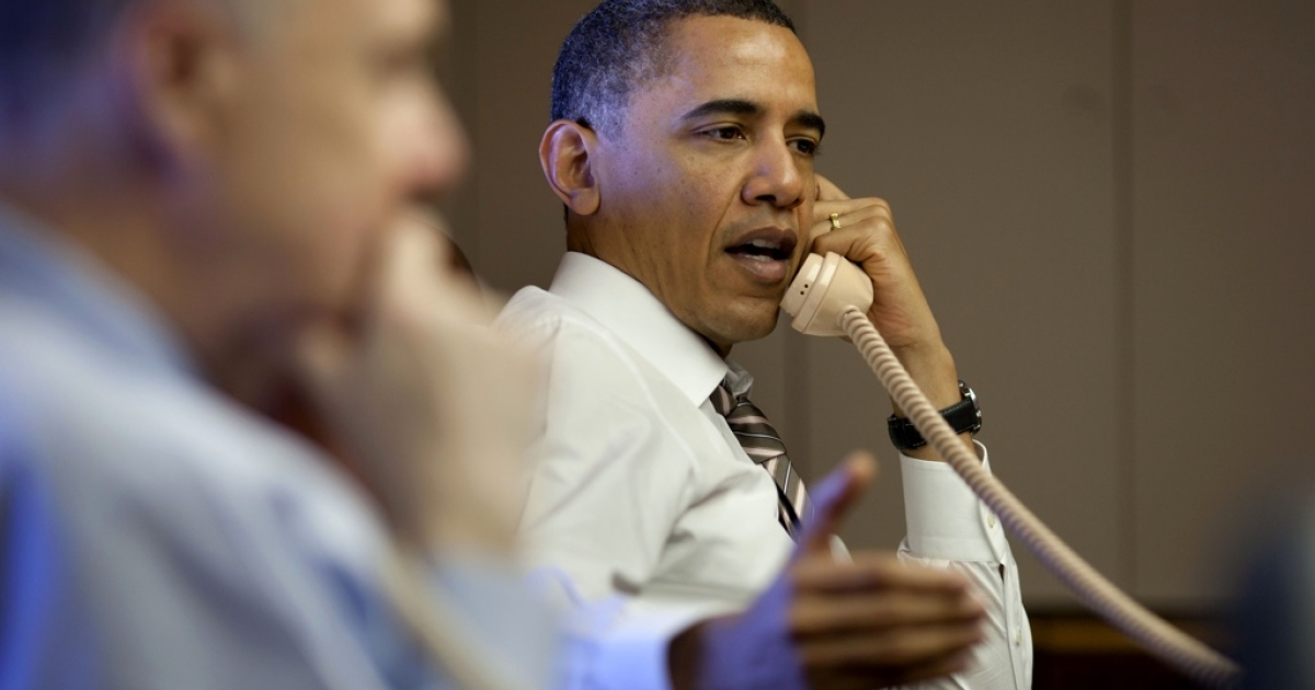 President Barack Obama leads a briefing on Libya by National Security Advisor Tom Donilon, (L) and Chief-of-Staff Bill Daley, during a secure conference call aboard Air Force One in flight from Rio de Janeiro, Brazil to Santiago, Chile on March 21, 2011.</p>