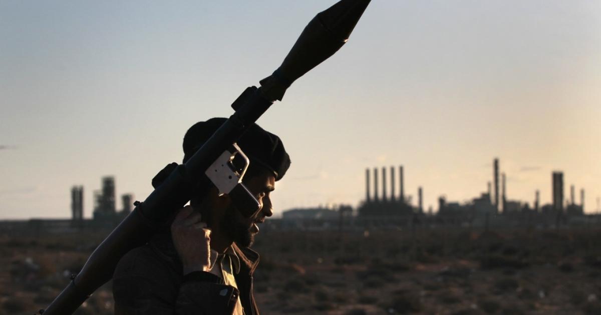 A Libyan rebel carries a rocket propelled grenade near strategic petroleum facilities on March 6, 2011 in Ras Lanuf, Libya.</p>