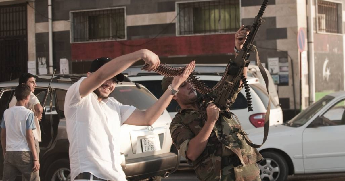 Don't try this at home: A Libyan rebel fires a machine gun into the air in celebration.</p>