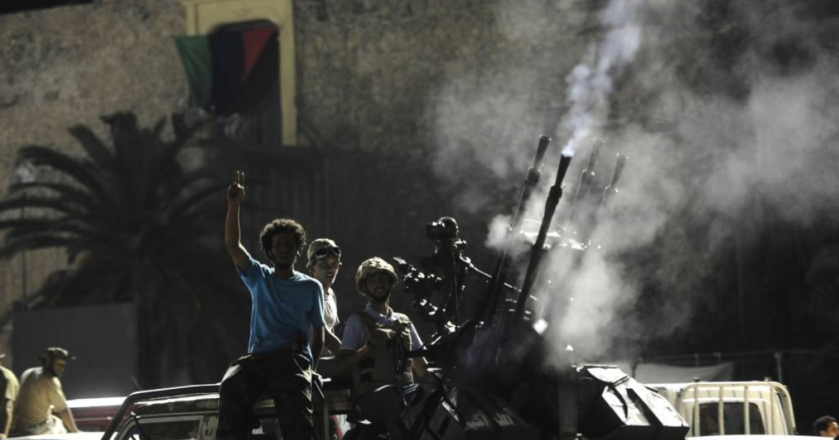 Rebel fighters fire in the air as they celebrate the capture of Gaddafi's compound in Tripoli on Tuesday, Aug 23 2011.</p>