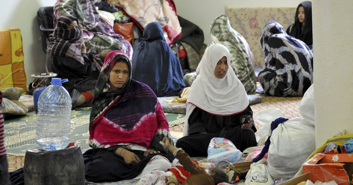 Women and children take shelter Friday in Sabha, Libya, a day after fresh clashes between rival  tribes killed eight people, a hospital official said. A government spokesman said today that a ceasefire has ended the killing.</p>