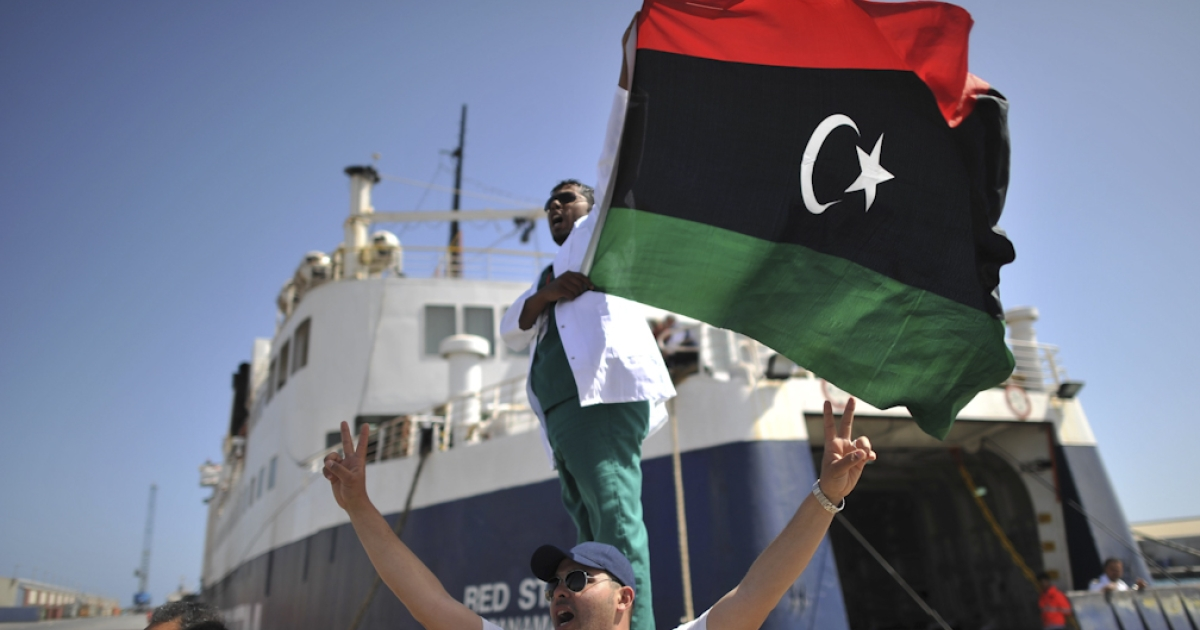 Libyan medic celebrates as they arrive in the port of Misurata after days of waiting out at sea on May 4, 2011, to evacuate civilians and wounded from this restive city being pounded by Libyan leader Muammar Gaddafi's forces.</p>