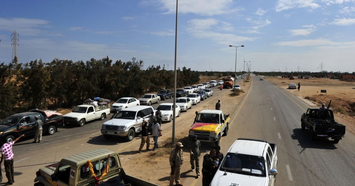 Evacuees from Muammar al-Gaddafi's hometown of Sirte line up their cars while waiting to cross a check point between Sirte and Misrata on October 04, 2011.</p>