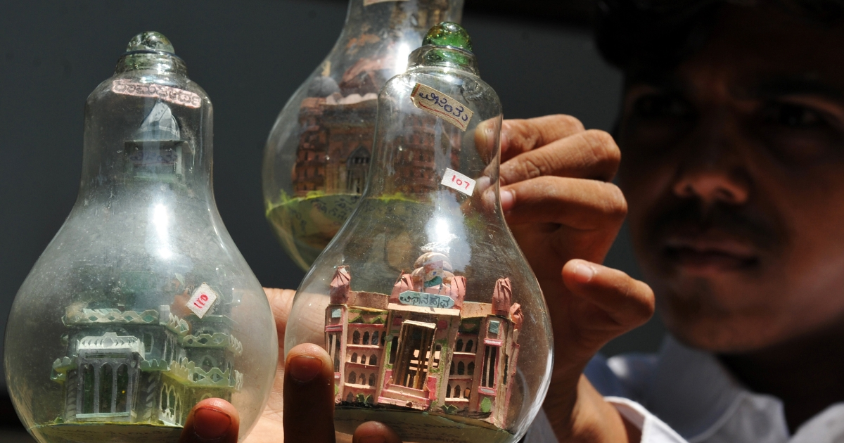 New use for an old favorite? Indian artist Vijay Kumar B Pawar shows artwork inside light bulbs in Bangalore on April 16, 2010.</p>