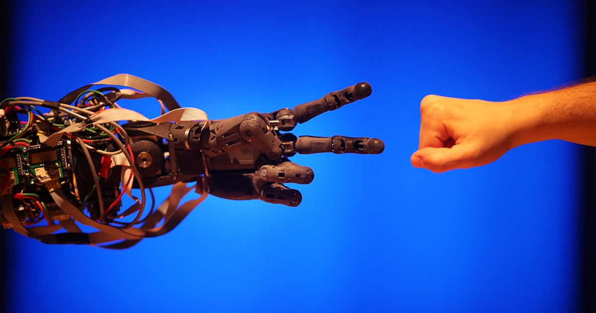 A Science Museum employee plays a game of 'paper scissors stone' with BERTI the robot at The Science Museum's Antenna Gallery in London. Feb. 17, 2009. BERTI is a life size humanoid robot built to mimic human gestures.</p>