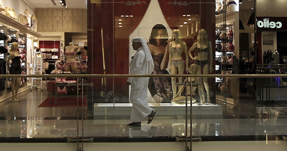 A Bahraini man walks past a lingerie shop at a mall in central Manama on March 22, 2011. Pro-democracy protests in Bahrain began on February 14 and Bahraini security forces carried out a bloody crackdown on the demonstrators.</p>