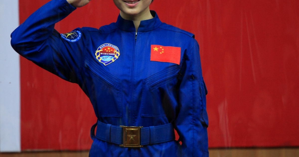 Chinese first woman astronaut Liu Yang salutes as she was introduced during a press conference at the Jiuquan space base, north China's Gansu province on June 15, 2012.</p>