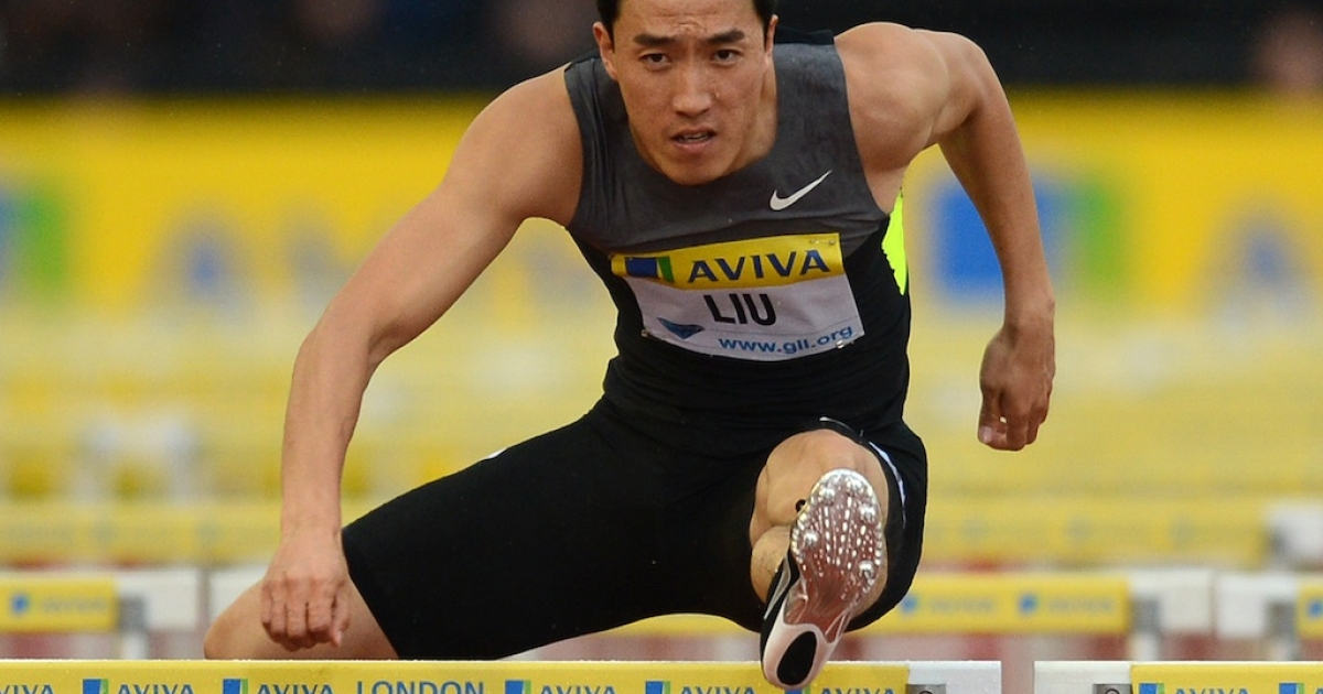 China's Liu Xiang competes in the men's 110m hurdles heat at the Diamond League London Grand Prix on July 13, 2012. Liu pulled out of the final due to muscle pain.</p>