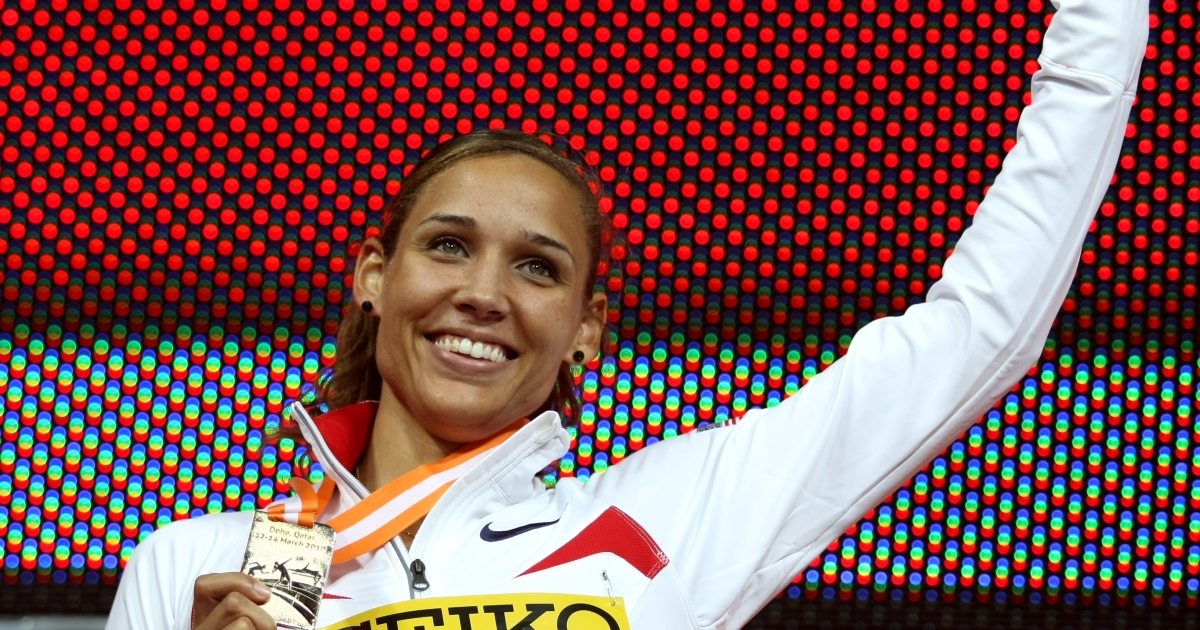 Lolo Jones poses with her gold medal on the podium of the women's 60m hurdles final at the 2010 IAAF World Indoor Athletics Championships at the Aspire Dome in the Qatari capital Doha on March 13, 2010.</p>