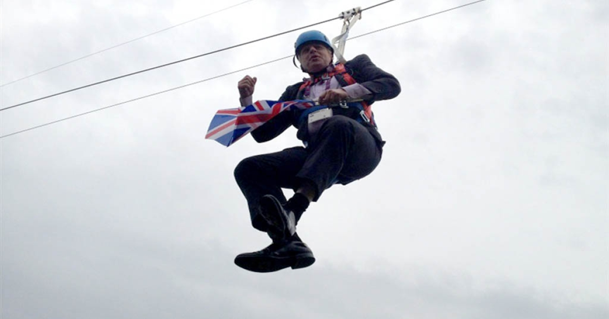 Twitter user Rebecca Denton posted a photo of the Mayor dangling on a zip line.