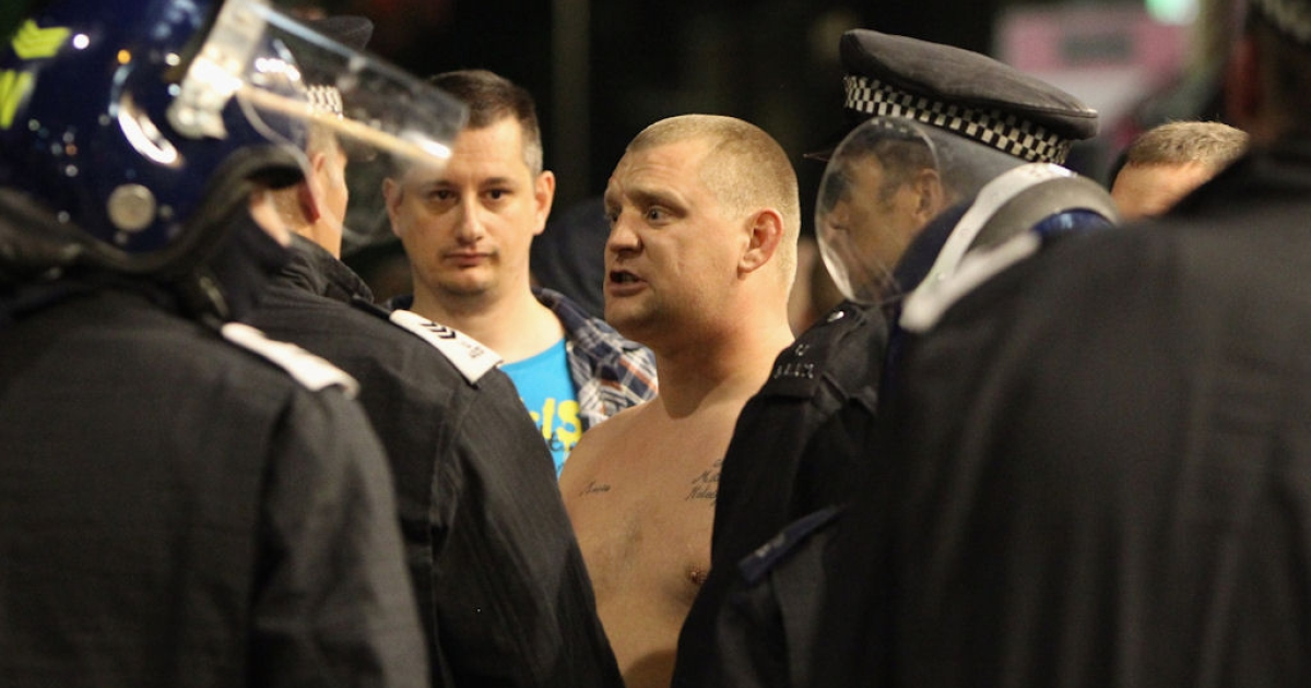 Men angry about recent rioting and looting come out in Eltham to protect their properties on Aug. 9, 2011 in London, England.</p>