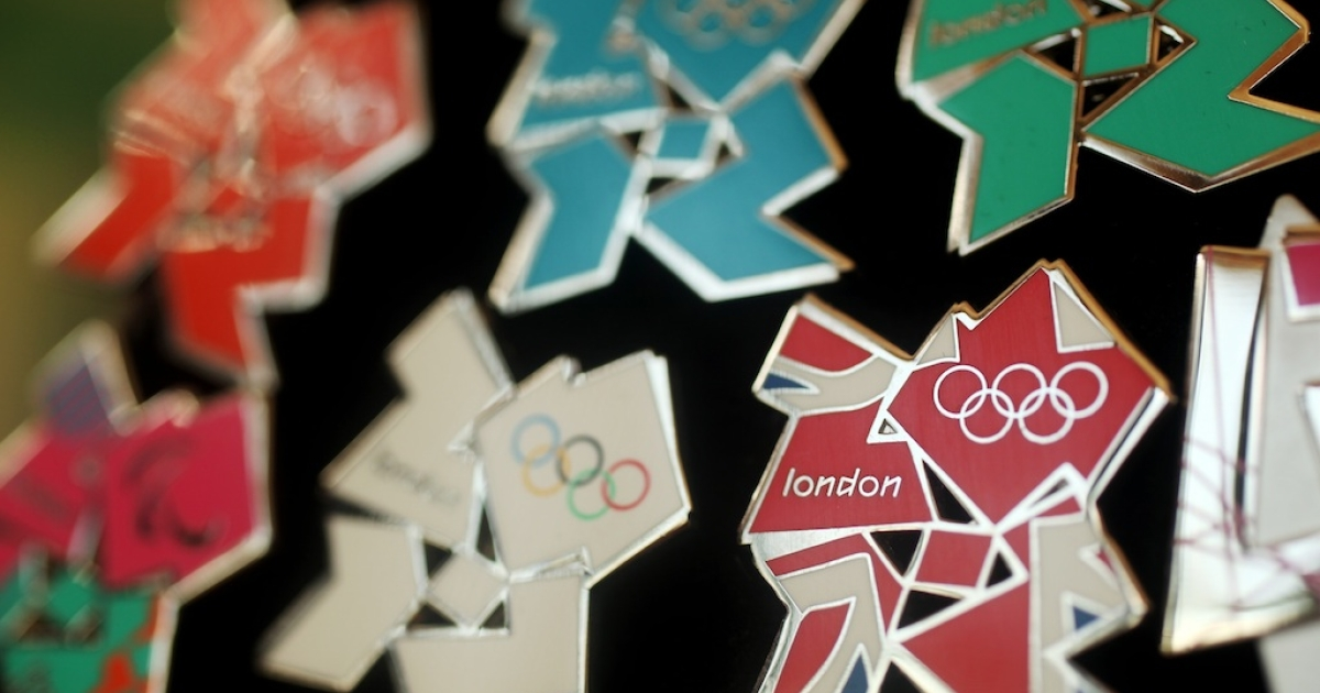 London 2012 pin badges go on display at the launch of the London Olympic Games official merchandise on July 30, 2010 in London, England. Unlike any previous Olympic logo, the official London 2012 emblem has been reproduced in multiple colors including pink, green, orange, and blue, among others.</p>