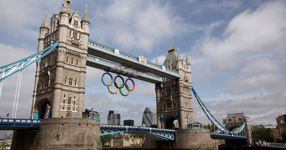 LONDON, ENGLAND - JUNE 27:  A giant set of Olympic rings are displayed from Tower Bridge on June 27, 2012 in London, England. The rings weigh over three tonnes and measure over 25 metres wide by 11.5 metres tall; they will be illuminated in a light-show every evening during the Games.  (Photo by Oli Scarff/Getty Images)</p>