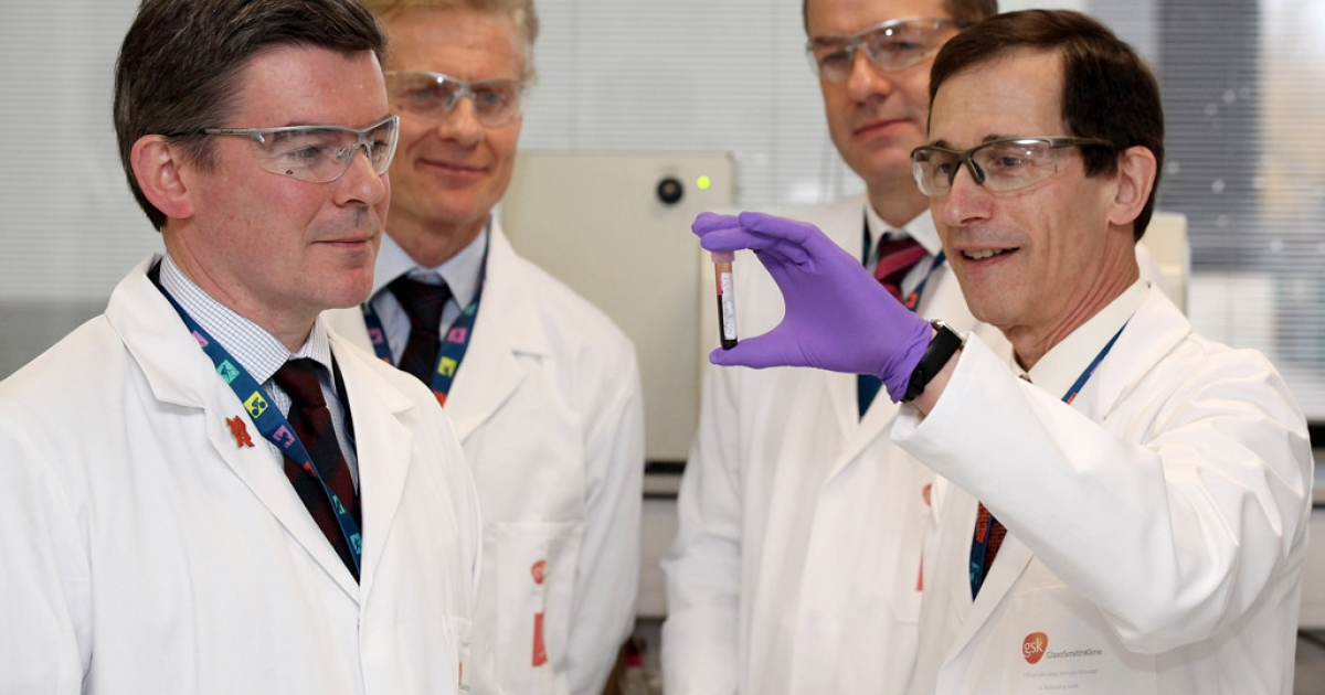 Olympics minister Hugh Robertson (left), London 2012 Chief Executive Paul Deighton (second from left), and CEO of GSK Sir Andrew Witty (2nd from right), are shown a vial of blood by Professor David Cowan, the Head of Science for London 2012, in the anti-doping laboratory which will test athlete's samples from the London 2012 Games.</p>