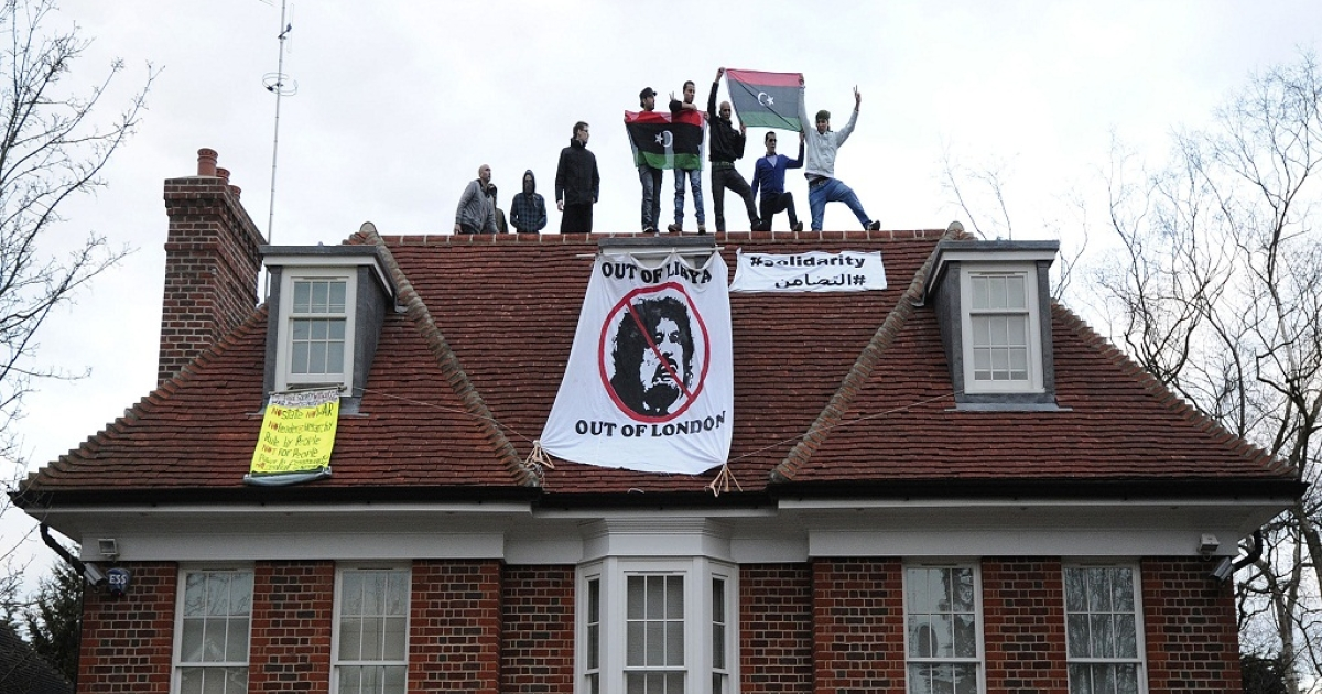 Squatters and demonstrators are pictured on the roof of a house belonging to Seif al-Islam, the son of Libyan dictator Moamer Kadhafi, in Hampstead, north London, on March 9, 2011. A government report estimates roughly 20,000 squatters occupying London homes today.</p>