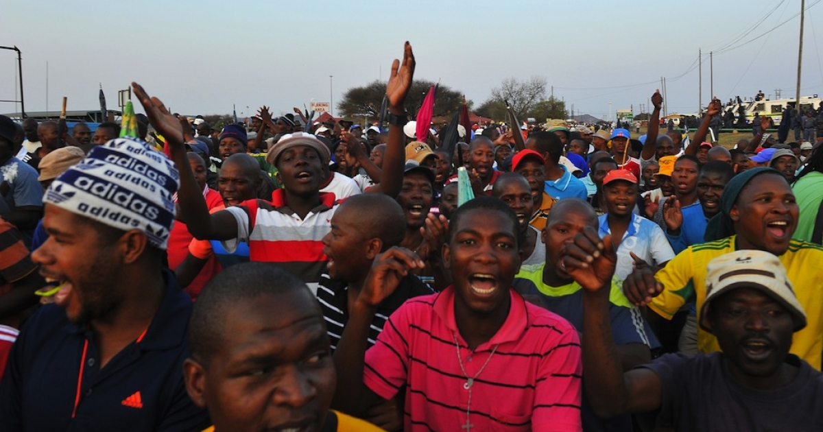 Striking mine workers in South Africa celebrate after receiving a 22 percent pay increase from London-listed Lonmin on September 18, 2012.</p>