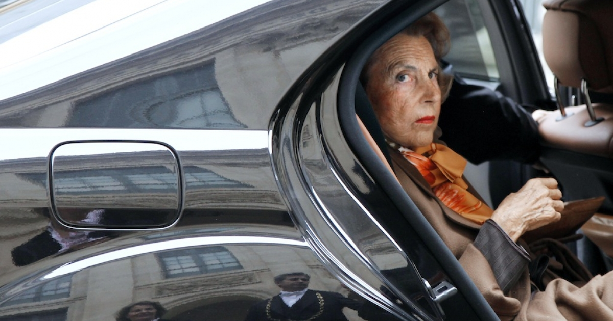 French billionaire L'Oreal heiress Liliane Bettencourt arrives by car at the Institut de France on Oct. 12, 2011 in Paris.</p>