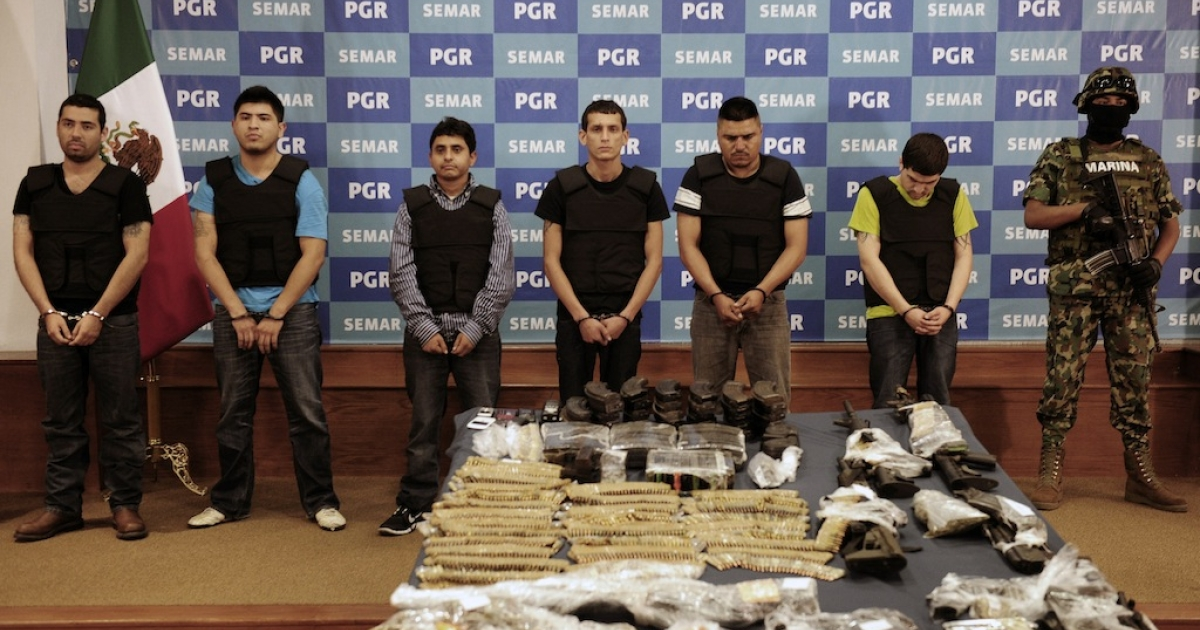 Salvador Alfonso Martinez, aka 'Ardilla', (3rd-L), alleged member of the Los Zetas Cartel and alleged mastermind of the San Fernando slaugther, is presented with accomplices to the media at the General Attorney's offices in Mexico City, on Oct/ 8, 2012. Some 50,000 people have been killed in mostly drug-related violence in Mexico since 2006, when the government launched a massive military crackdown on the powerful cartels.</p>