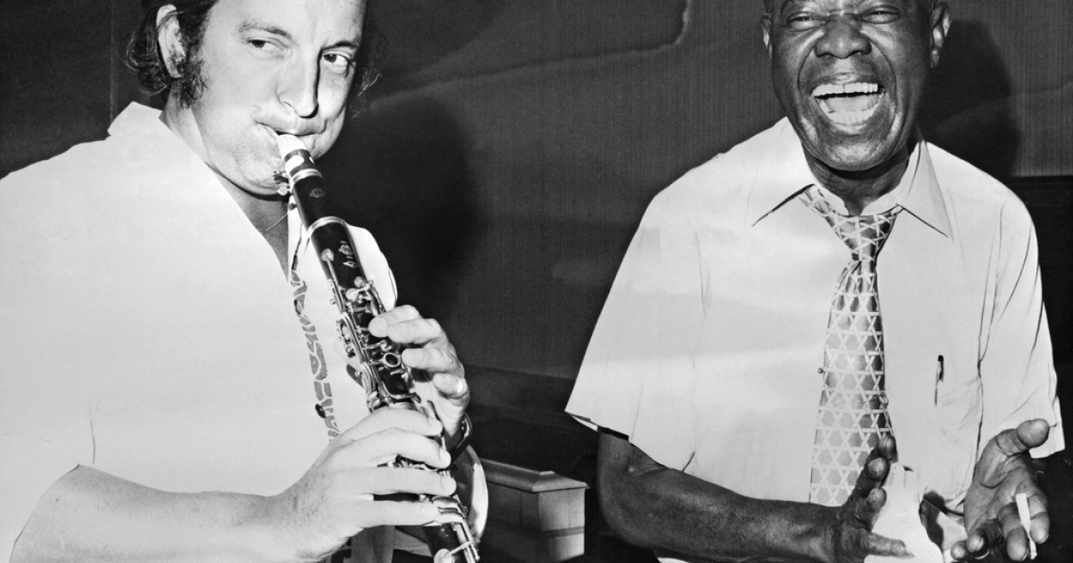 A picture taken in 1970 shows American Louis Armstrong (R), the jazz trumpeter whose melodic inventiveness established the central role of the improvising soloist in jazz, playing with French trumpeter Claude Luter.</p>