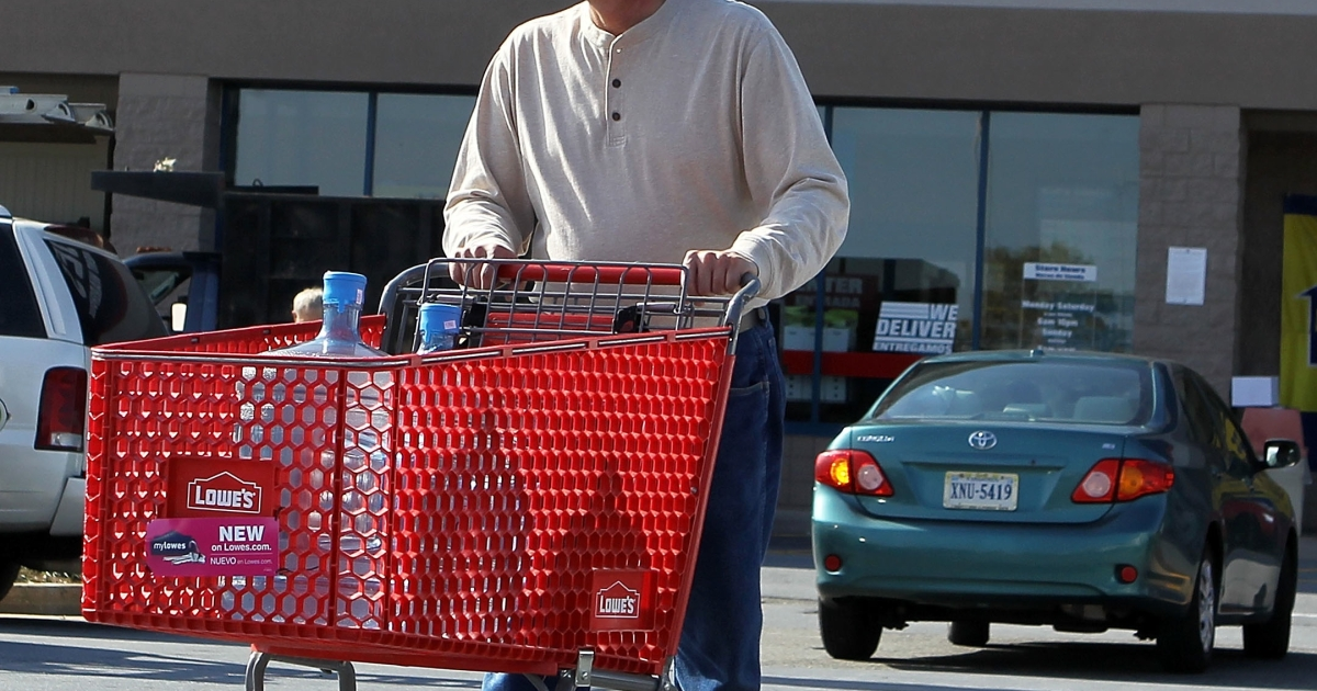 A customer comes out of a Lowe's store in Alexandria, Va., on Oct. 17, 2011.</p>
