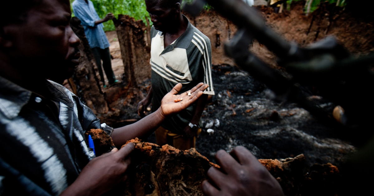 The Arrow Boys are a group of South Sudanese youths who try to protect their communities from the LRA. Here a group of Arrow Boys inspect the home of Tereza Polino, near Tambura, which was burned by the LRA.</p>
