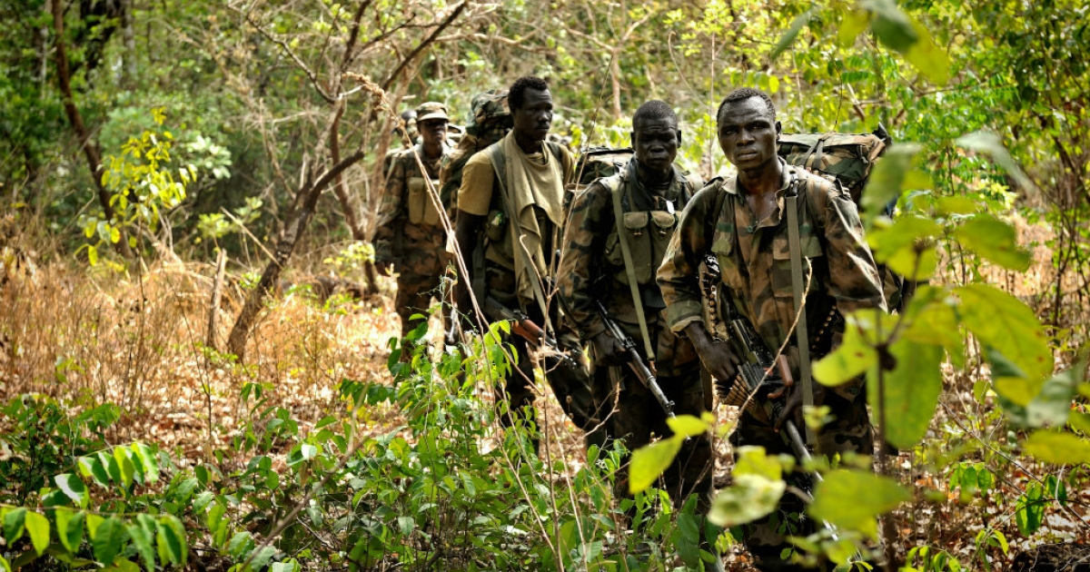 Ugandan soldiers patrol the central African jungle during an operation to find Lord's Resistance Army leader Joseph Kony.</p>