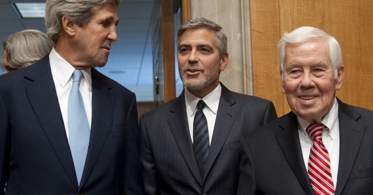 Senator Richard Lugar (R-Indiana), right, with actor George Clooney and Senator John Kerry (D-MA), Chairman of the Senate Foreign Relations Committee in Washington, DC, March 14, 2012.</p>