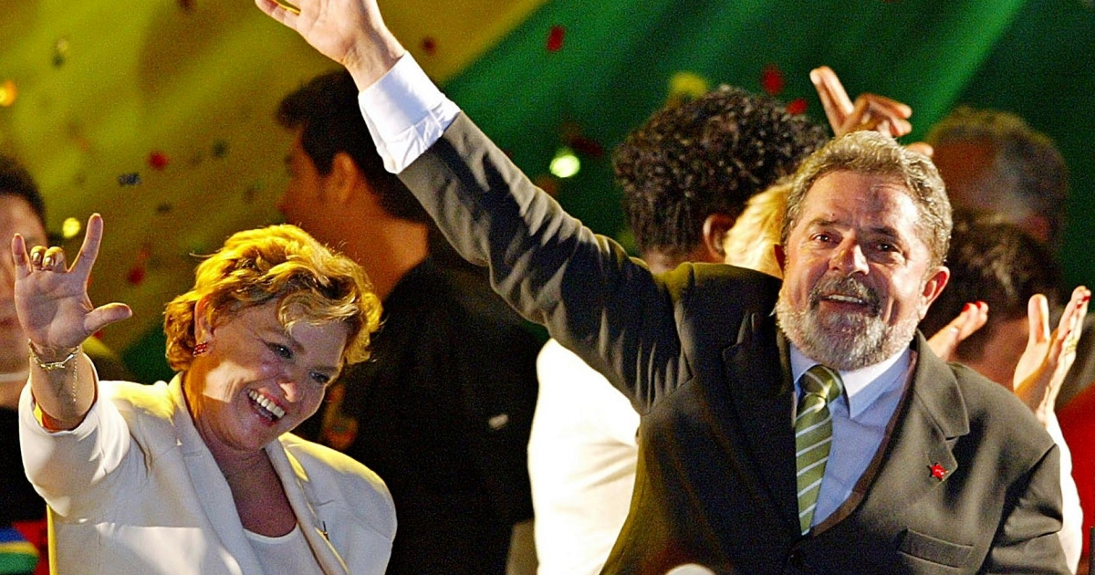 Luiz Inacio Lula da Silva, right, and his wife Marisa wave to supporters Oct. 28, 2002, after Lula won Brazil's presidential election with a record 52 million votes, or over 60 percent of the total. Campaign marketers had helped transform his image from radical unionist to fatherly leader.</p>