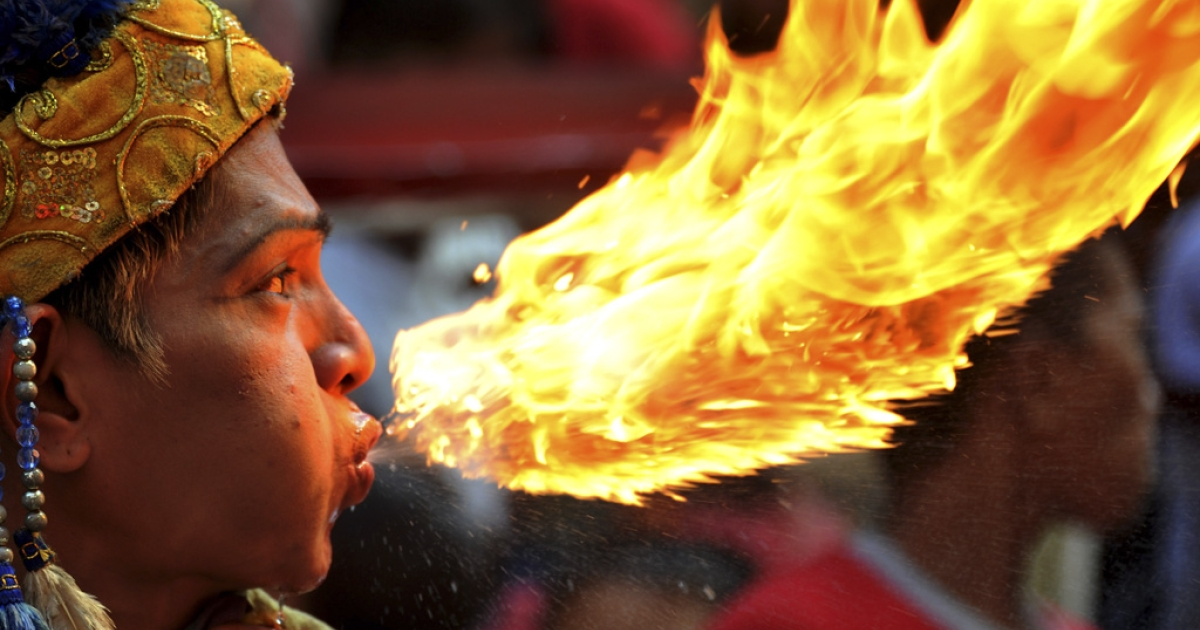 A fire breather performs in Manila on Sunday.</p>