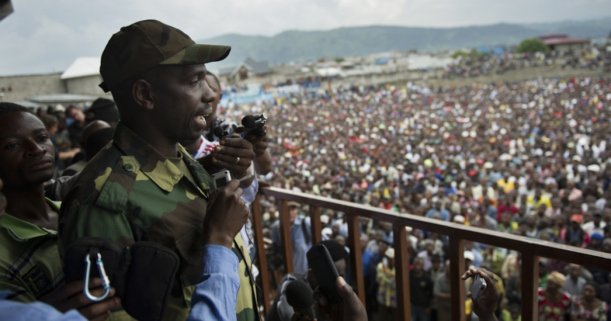 Spokesman of the M23 rebel group Lieutenant-Colonel Vianney Kazarama addresses a crowd at the Volcanoes Stadium in Goma, in the east of the Democratic Republic of the Congo, on November 21, 2012. Lt.-Col. Kazarama addressed the population of Goma today in an attempt to calm and reassure the civilians following the fall of Goma to M23 rebels yesterday.</p>
