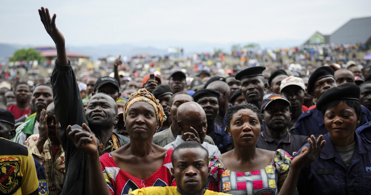 Residents of Goma react as they listen to M23 rebel group spokesman at the Volcanoes Stadium in Goma, in the east of the Democratic Republic of the Congo, on Nov. 21, 2012. Rwanda denied on July 30, 2013 claims by the United States that it backs M23 rebels in neighboring DR Congo.</p>