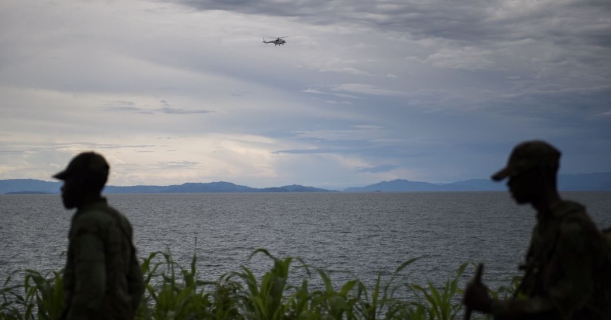 A United Nations helicopter flies over the Lake Kivu in the city of Goma in the east of the Democratic Republic of the Congo on November 20, 2012.</p>