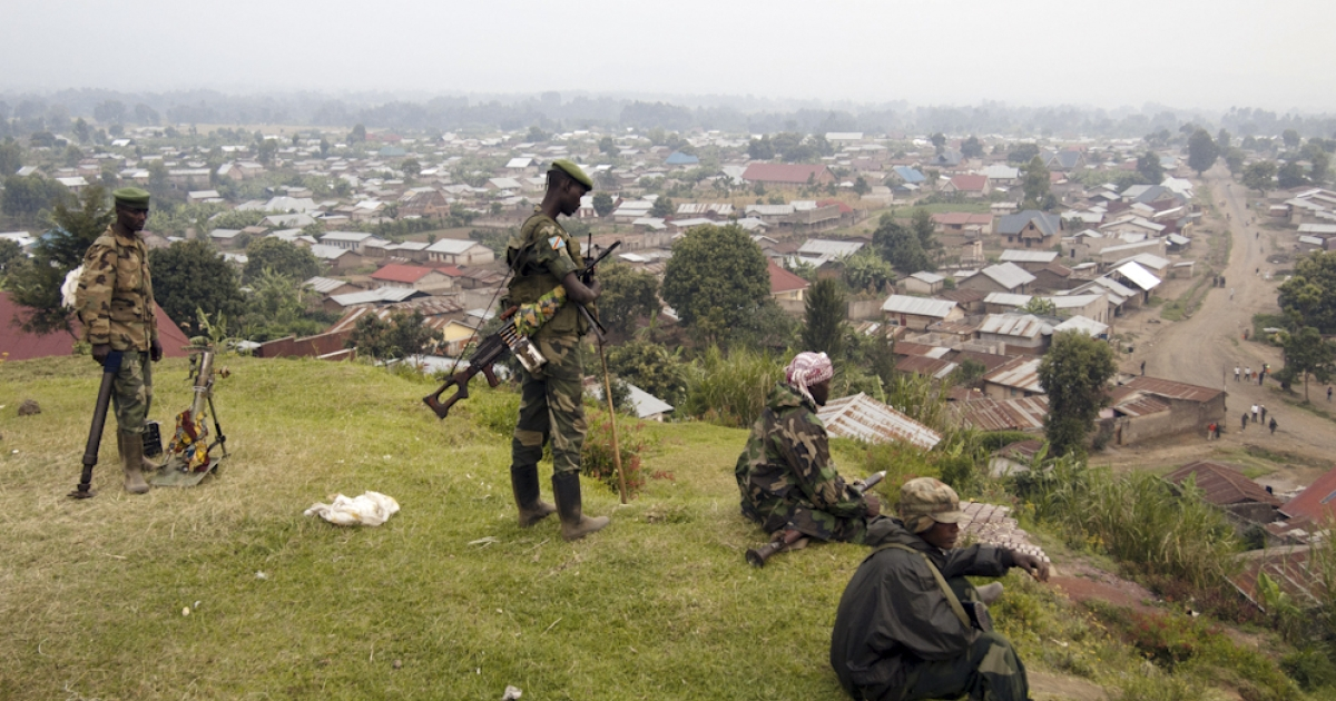 Rebels of the M23 group man their position on a hill overlooking Bunagana, a town near the Ugandan border on July 8, 2012. Mutineers from the Democratic Republic of Congo on Sunday seized control of three towns in the country's eastern Nord-Kivu province, an AFP correspondent reported today. The rebels, known as M23, took Rutshuru and the towns of Ntamugenga and Rubare, less than 10 kilometres away on the road to the provincial capital Goma, shortly after 12:00 pm local time.</p>