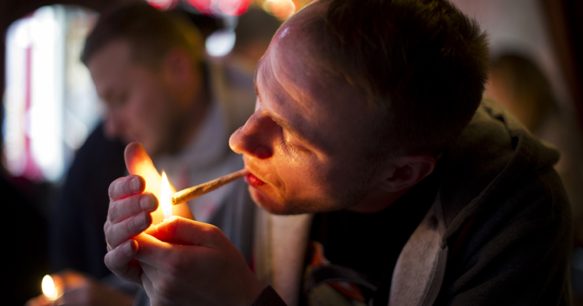 Jay, a 29-year-old from London, lights a cannabis joint in a coffee shop on Nov. 1, 2012, in the center of Amsterdam, Netherlands. The ban on foreigners entering coffee shops came into effect last May in the Netherlands' southern provinces, but after intense lobbying by city authorities in Amsterdam it's now up to each city to decide how to apply the cannabis laws.</p>