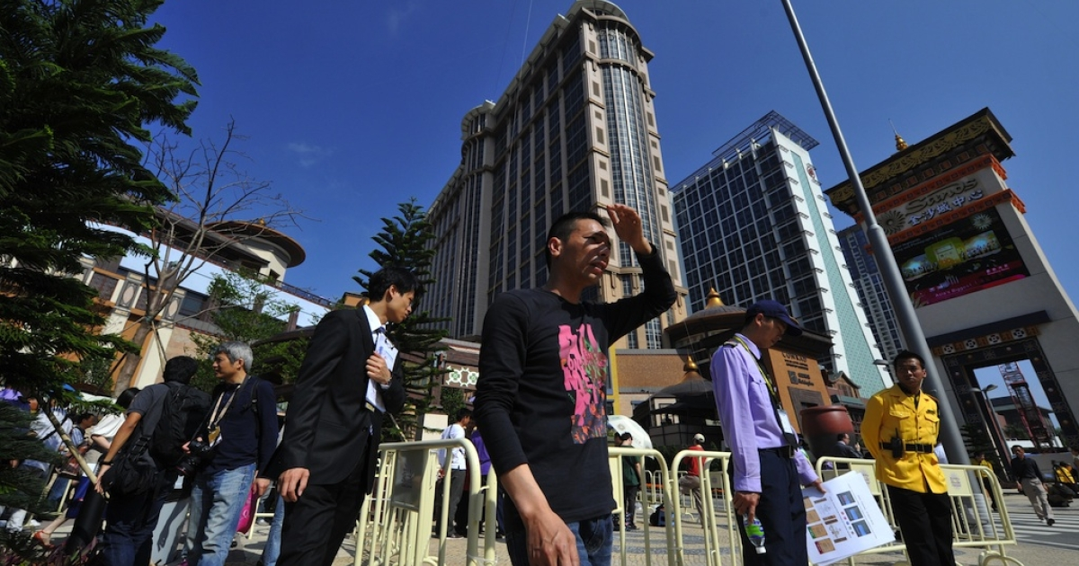 People walk past the Sands Cotai Central before the opening of the resort in Macau on April 11, 2012.</p>