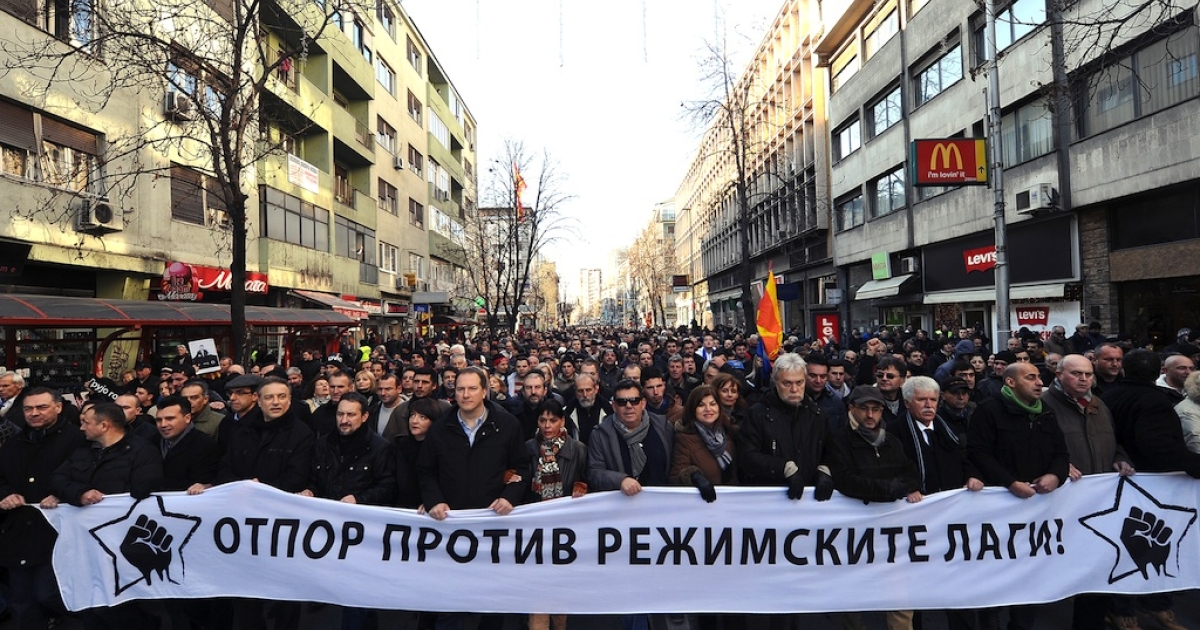 Macedonian opposition supporters carry on January 12, 2013 a banner, reading: 'Resistance Against the Lies of the Regime,' during a protest called the 'Truth March' in Skopje. Macedonia on January 11 called local elections for March 24 in a tense political climate that has reigned since opposition boycotted parliament last month. Macedonia has been in a deep political crisis since December 24, when 17 people, including 11 policemen and two deputies, were slightly injured in scuffles over the 2013 budget.</p>