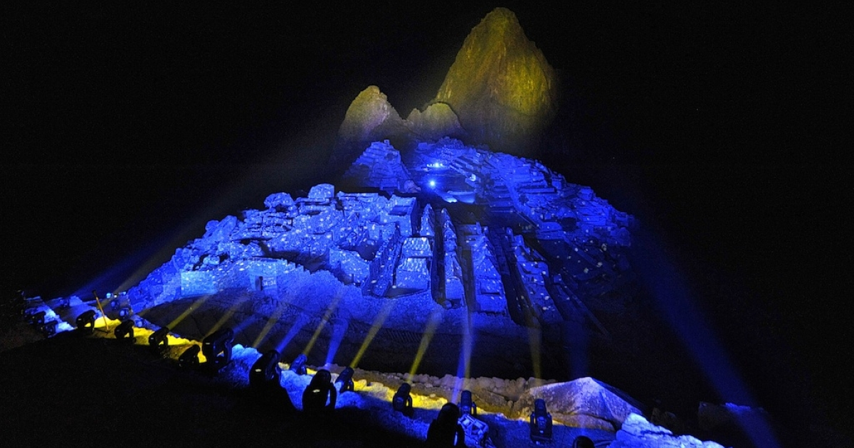 The ruins of the Inca citadel of Machu Picchu are lit with colored light on the evening of July 7, 2011. The complex, which was unknown to Spanish conquerors, is now visited by up to 250,000 people a year.</p>