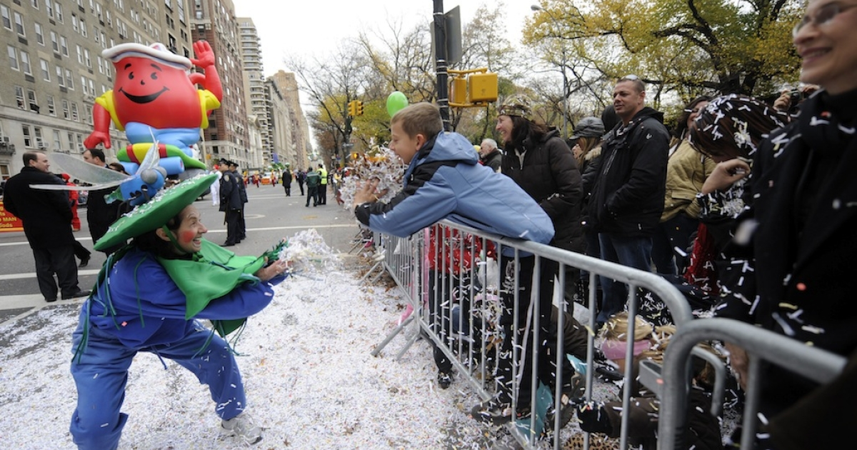 Children throw confetti during the 84th annual Macy's Thanksgiving Day Parade in New York Nov. 25, 2010.</p>