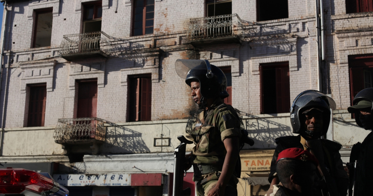 Security forces stand guard in the center of Antananrivo, Madagascar, on May 19, 2012, after 3000 to 5000 people gathered in the city center for a demonstration called by the main opposition radio, Free FM. The police violently dispersed the non-authorised protest and arrested several people.</p>