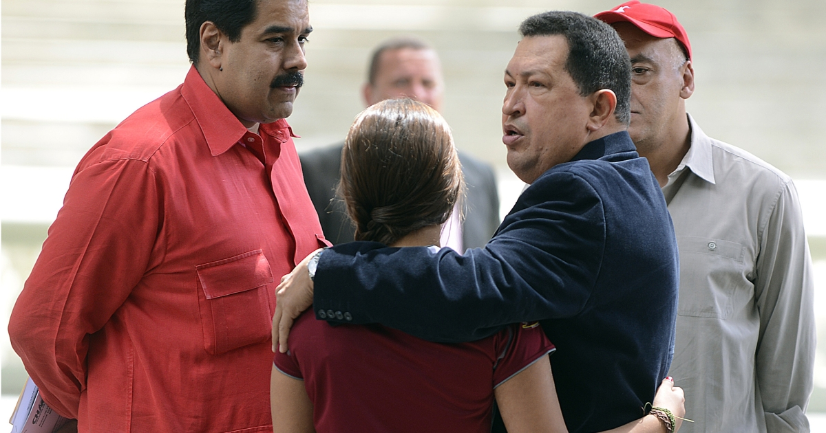 Venezuelan President Hugo Chavez, right, hugs his daughter Rosa Ines as he speaks with Nicolas Maduro, his No. 2 who he said should be first to succeed him.</p>