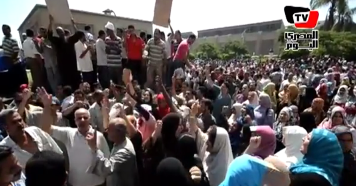 This screenshot from Egyptian TV shows massive crowds protesting in the Nile Delta city Mahalla, where thousands of textile workers have been on strike for days.</p>