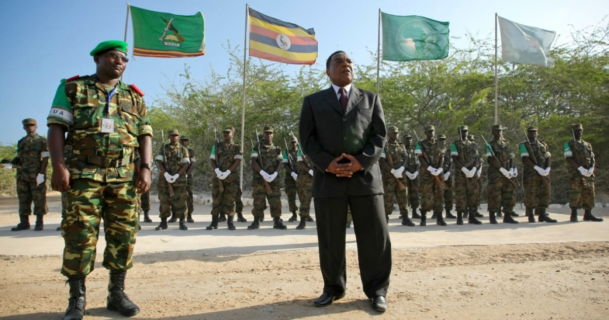 Augustine Mahiga, right, Special Representative of the Secretary-General for the United Nations Political Office in Somalia (UNPOS), stands with the Deputy Force Commander of the African Union Mission in Somalia (AMISOM), Brigadier-General Audace Nduwumunsi, while addressing troops and officers at the mission's headquarters following his arrival in the Somali capital on January 24, 2012. The United Nations office for Somalia relocated from the Kenyan capital to Mogadishu, resuming operations in the war-torn Somali city after a 17-year-absence.</p>