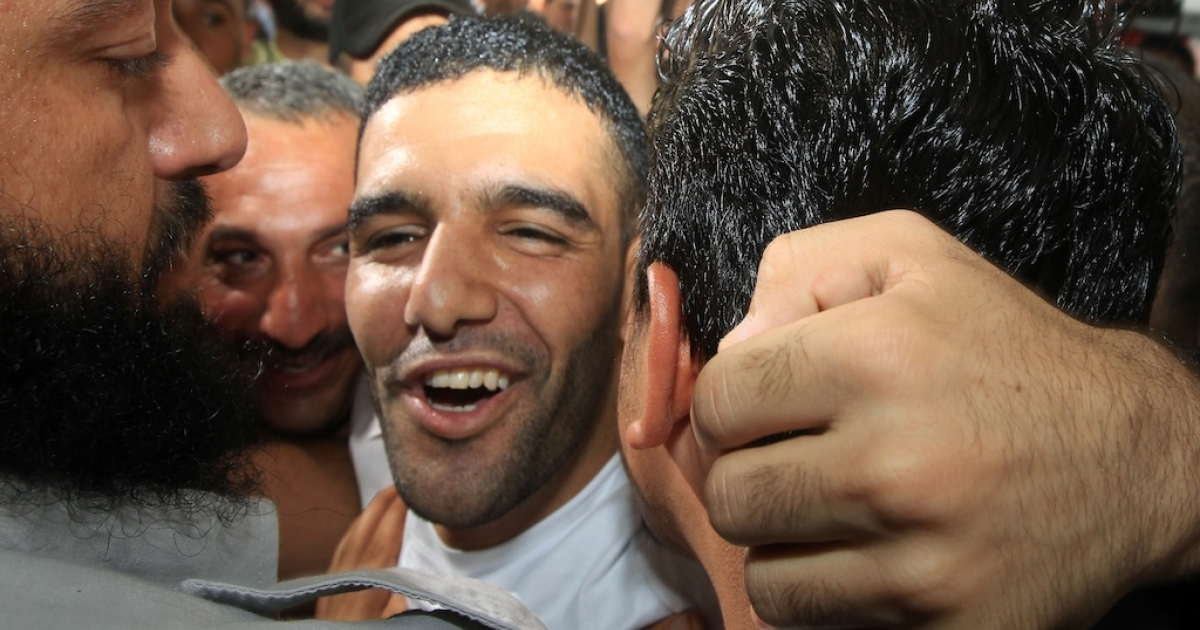 Mahmud Sarsak (C), a Palestinian football player, staged a hunger strike for nearly three months while in Israeli jail. He is greeted by relatives and supporters as he arrives at the Al-Shifa hospital in Gaza City on July 10, 2012, after his release from Israeli prison. Sarsak staged a hunger strike of nearly three months to protest his detention without charge under Israel's 'unlawful combatants' law. His detention order was due to expire or be renewed on August 22.</p>