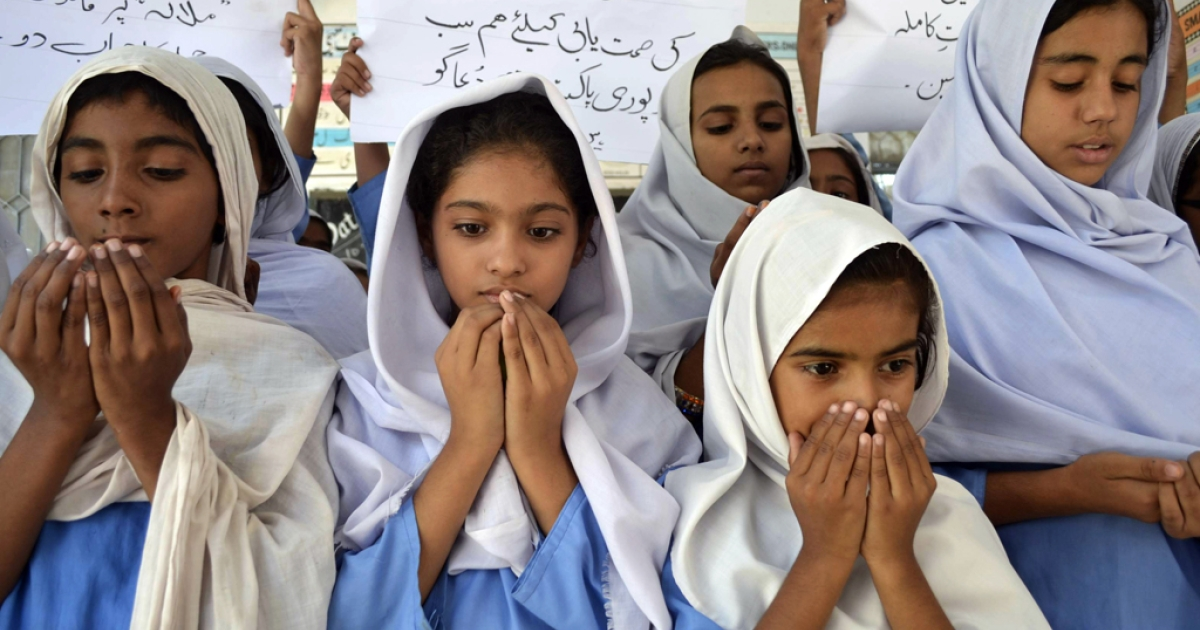 Pakistani school girls pray for the recovery of gunshot victim, Malala Yousafzai, in Multan on October 10, 2012. Pakistani doctors removed a bullet from a 14-year-old child campaigner shot by the Taliban in a horrific attack condemned by national leaders and rights activists. The attack took place in Mingora, the main town of the Swat valley in Pakistan's northwest, where Malala had campaigned for the right to an education during a two-year Taliban insurgency which the army said it had crushed in 2009.</p>