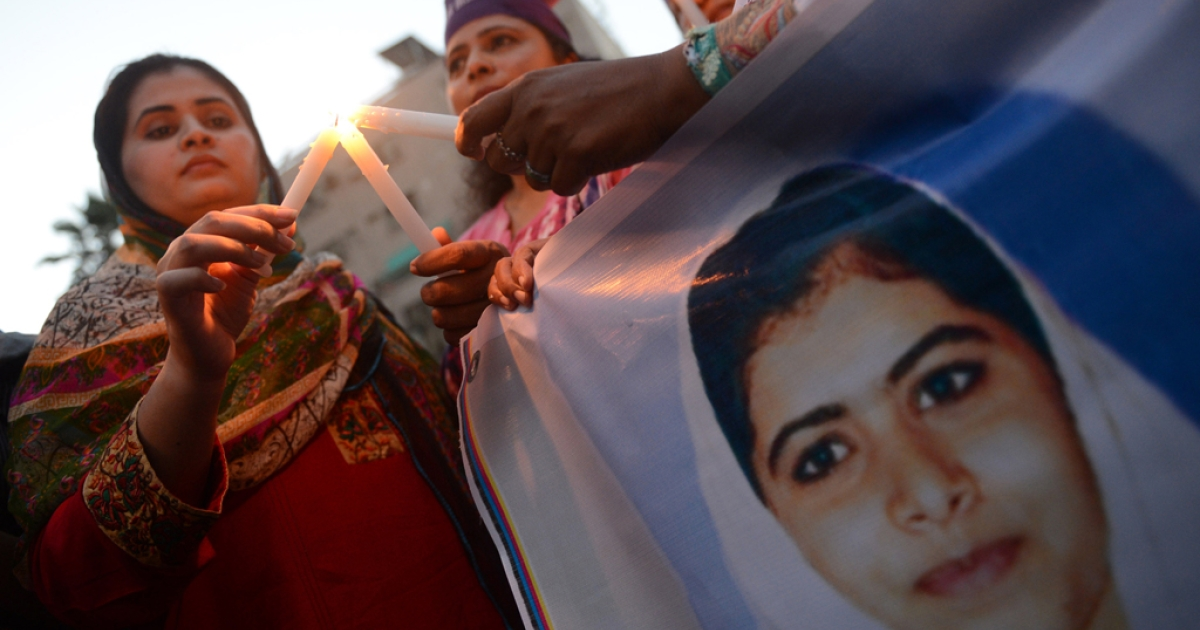 A Pakistani demonstrator lights a candle during a protest against the assassination attempt of child activist Malala Yousafzai, in Karachi on October 11, 2012. The Pakistani child activist that shot in the head by the Taliban was airlifted to the country's top military hospital for specialist treatment, is still in a critical condition, officials said. The shooting of 14-year-old Malala Yousafzai on a school bus in the Swat valley has been denounced worldwide and by the Pakistani authorities, who have offered a reward of more than US$100,000 for the capture of her attackers.</p>