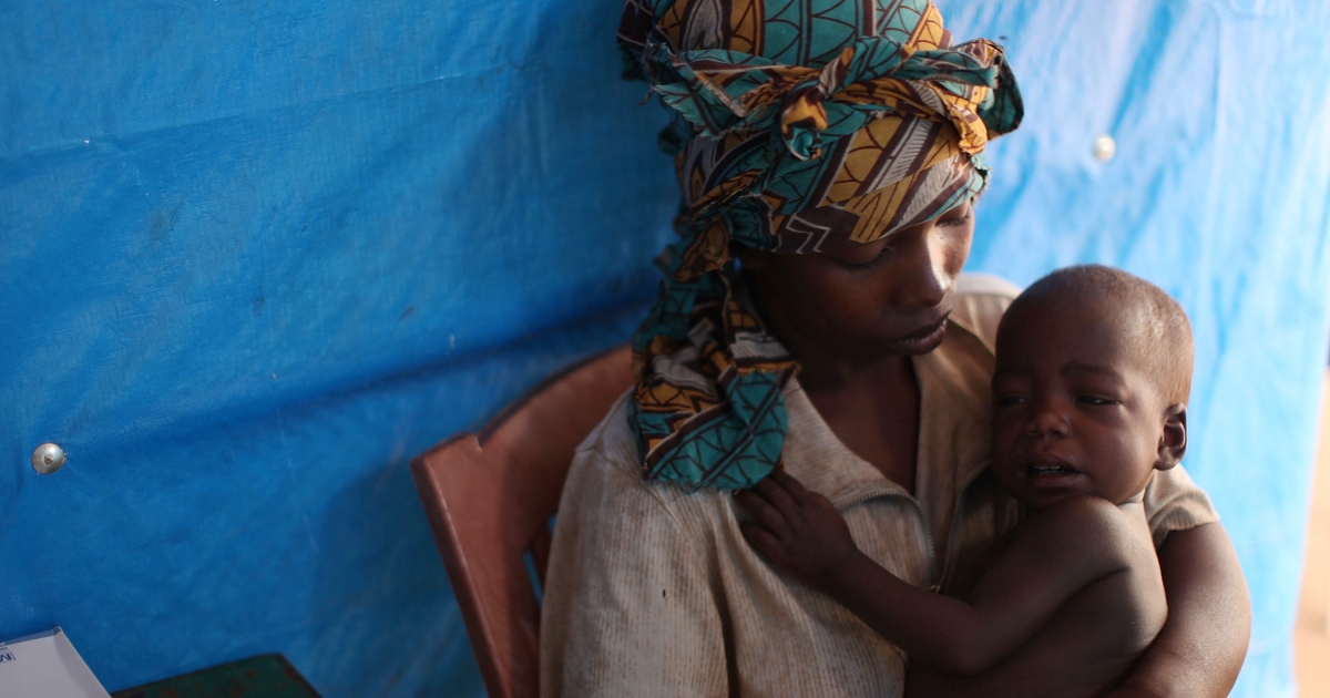 A Congolese woman and her malarial child speak with a doctor at the Makpandu refugee camp outside Yambio, south Sudan, on Jan. 14, 2011.</p>