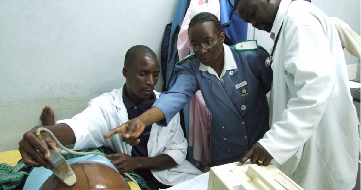 Malawian medical staff care for a pregnant woman at a clinic in the central town of Kasungu.</p>