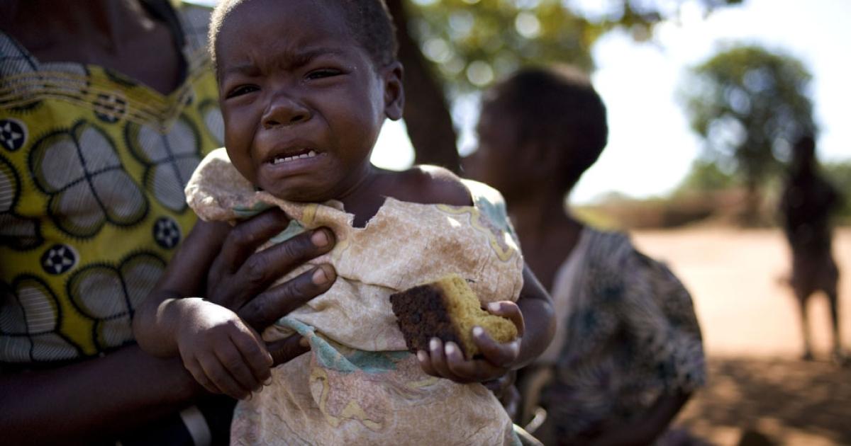 Eneta Sam holds her sick granddaughter Gloria Napialo who is HIV positive, in Chakwindima Village, Malawi on June 5, 2011.</p>